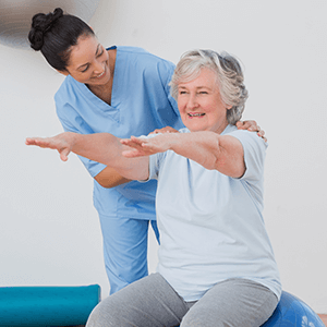 Rehabilitation Therapy - Therapist works on Physical Therapy with Senior Woman