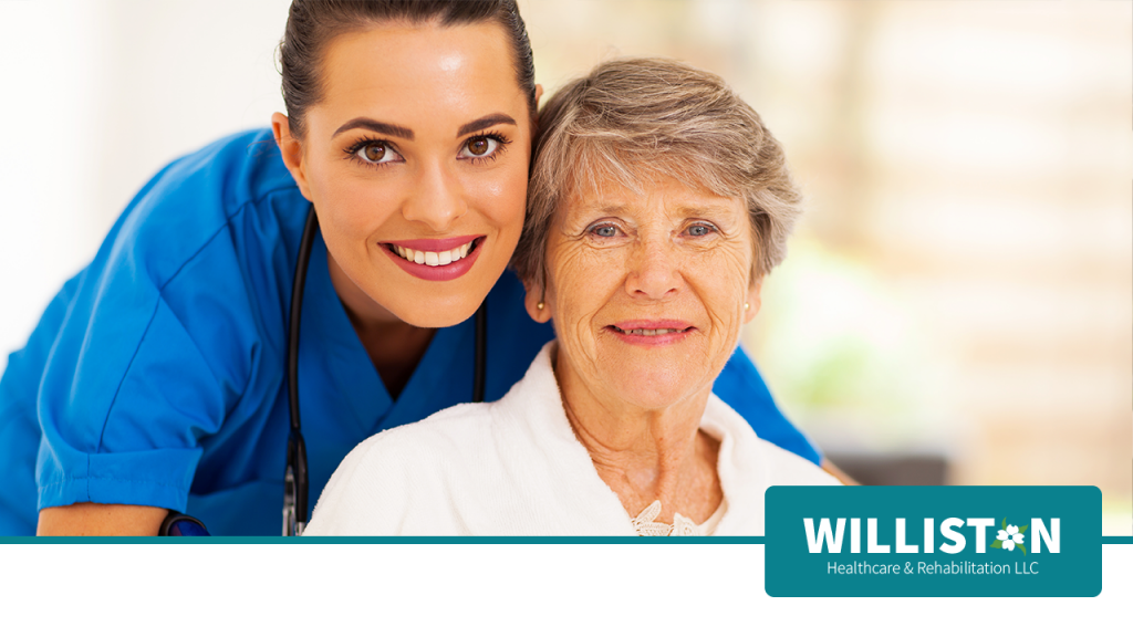 Nurse Smiles with elderly woman at Williston Healthcare & Rehabilitation LLC